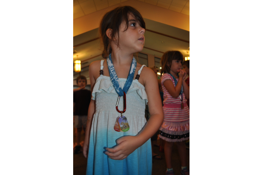 Gretta Bonifate, 5, performs motions to a worship song.