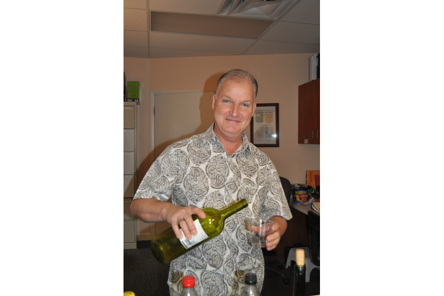 Ray Griffith volunteered his bartending skills for the event.