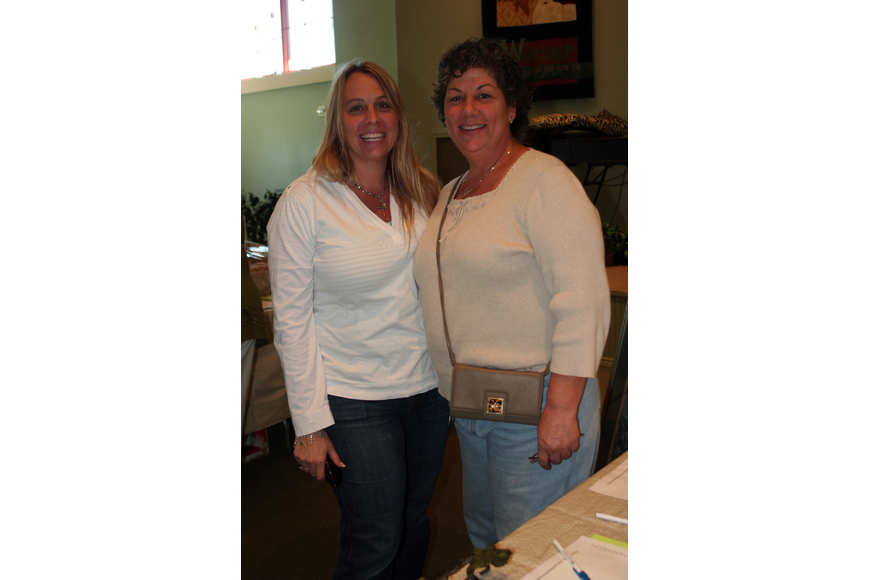 Kirstin Shontere and Lynn Haun enjoyed doing some Christmas shopping at the silent auction.