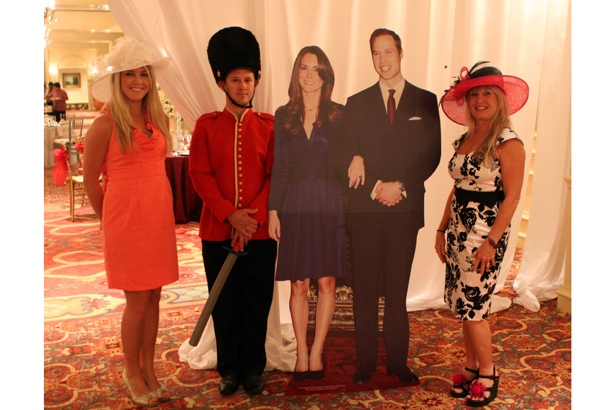 Kristin Hamilton and Jacki Kleppinger pose with a cardboard cut out of Prince William and Kate Middleton along with Chris Starman posing as a guard.