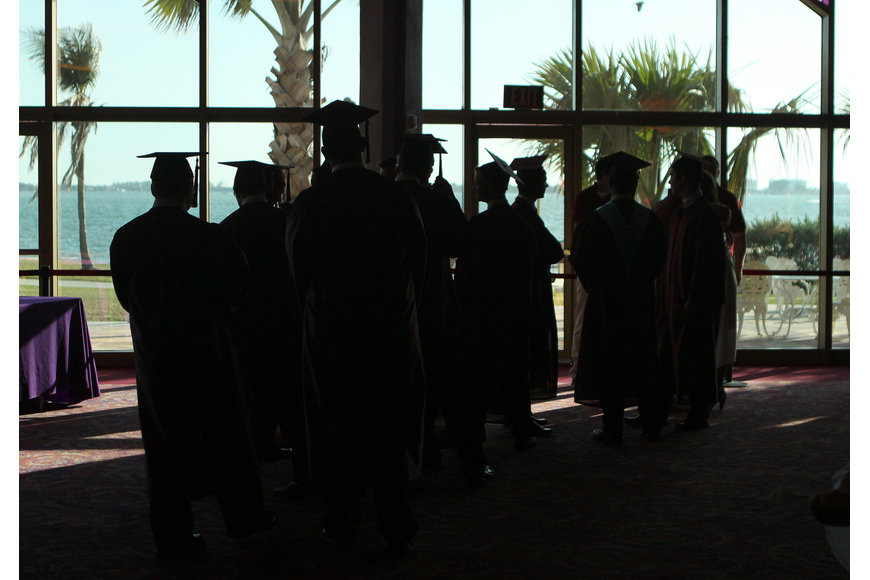 Silhouetted Cardinal Mooney seniors get ready to graduate Friday, May 27 at the Van Wezel Performing Arts Hall.
