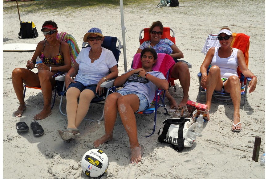 Volleyball player Monica Fernandez sits with her friends Rebecca Iglesias, Laura Diaz, Alina Diaz and Rebecca Diaz during a break from playing during the Siesta Key Gulf Open Saturday, July 9 at Siesta Key Beach.