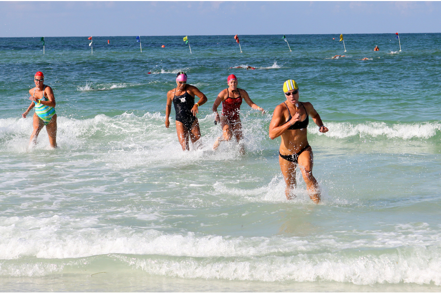 Lindsay Kenney, of Delray Beach, keeps ahead of her fellow lifeguard competitors to come in first in the ladies surf swim event Thursday, July 14 during the 2011 James
