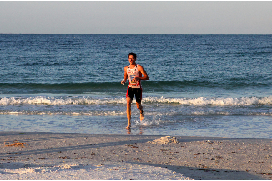 Thomas Barton was the first person to complete the swimming portion of the Siesta Key Triathlon Saturday, July 23 out at Siesta Key Public Beach. Barton had about a three-minute lead over the rest of his competitors.