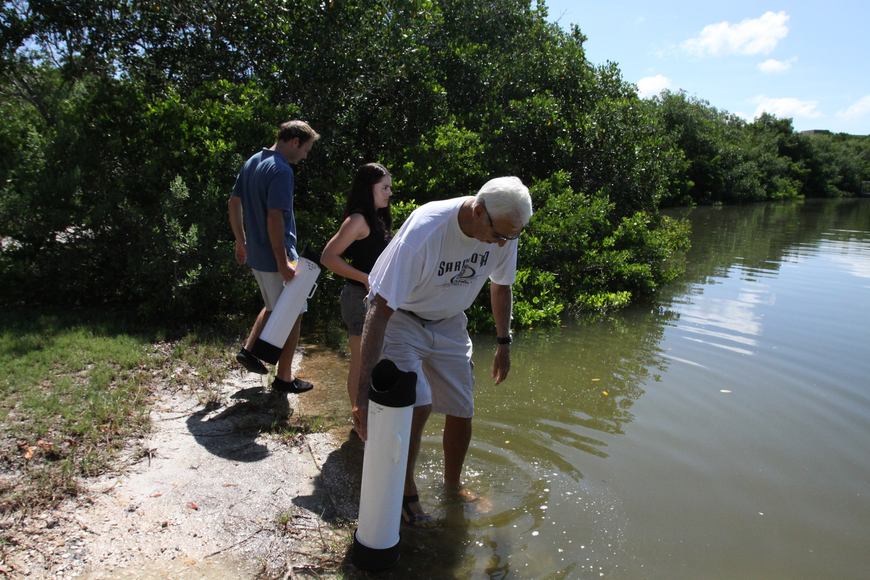 Chris Wetzig, Amanda Dominguez and Bob Clousson make their way into the water to try out the Aqua-Scopes and do a mini lesson Saturday, July 30 out in the water by the Turtle Beach Community Center