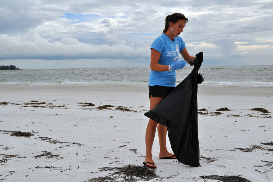 Lindsay Price cleans up South Lido Thursday, Sept. 8, at Ted Sperling Park.