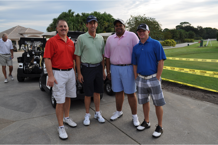 Sponsors of the BMW prize at hole six and employees for BMW of Sarasota Brian Dounan, Ed Seymour, Charles Wilson and Carey Paige.