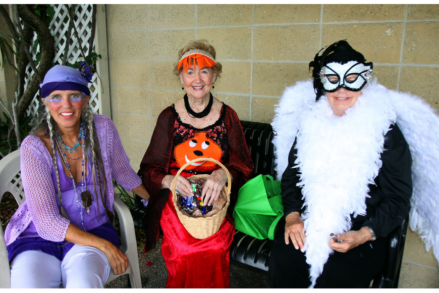 Jill Evans, Jeanene Kortjohn and Diane Erne dressed up and handed out candy, Monday, Oct. 31, during the Safe Kids trick-or-treating event in Siesta Key Village.