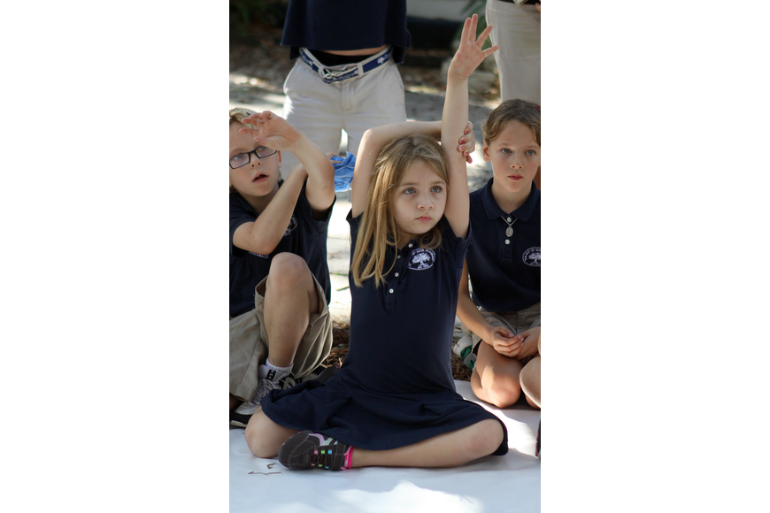 Peyton Wells, 7, raises her hand to ask Brian Wigelsworth a question about sand sculpting.
