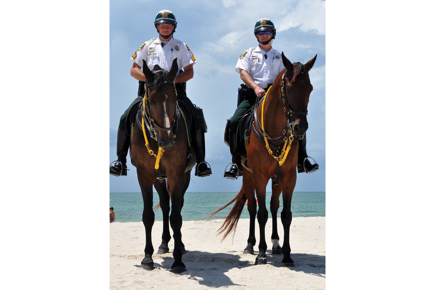 The Sheriff's Office Mounted Patrol officers not only help out with events such as the Drum Circle on the Key, they also use radar guns to catch speeders.
