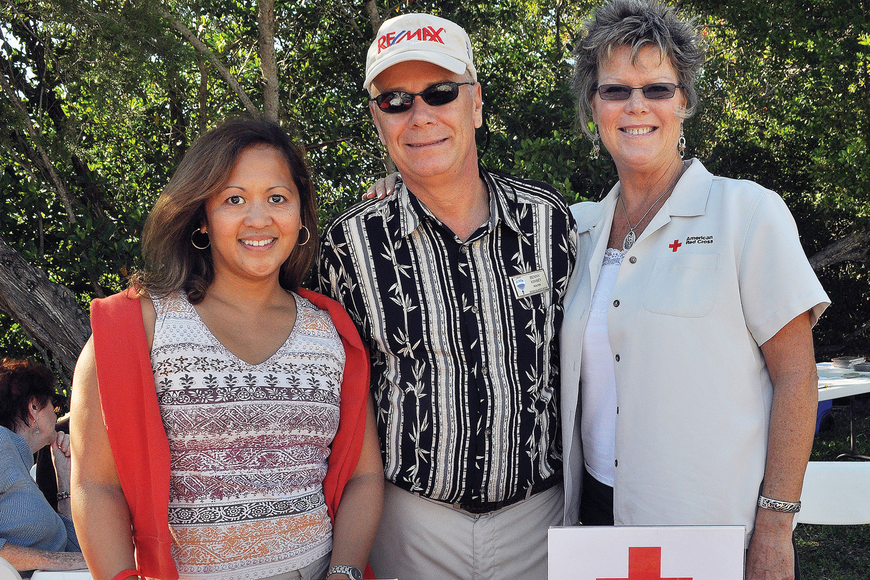 Beverly Arias, Benny Kimsey and Kimberley Reibel worked the Red Cross booth during the Nov. 12 revival of Kimsey's Bluegrass Picnic fundraisers on Turtle Beach.