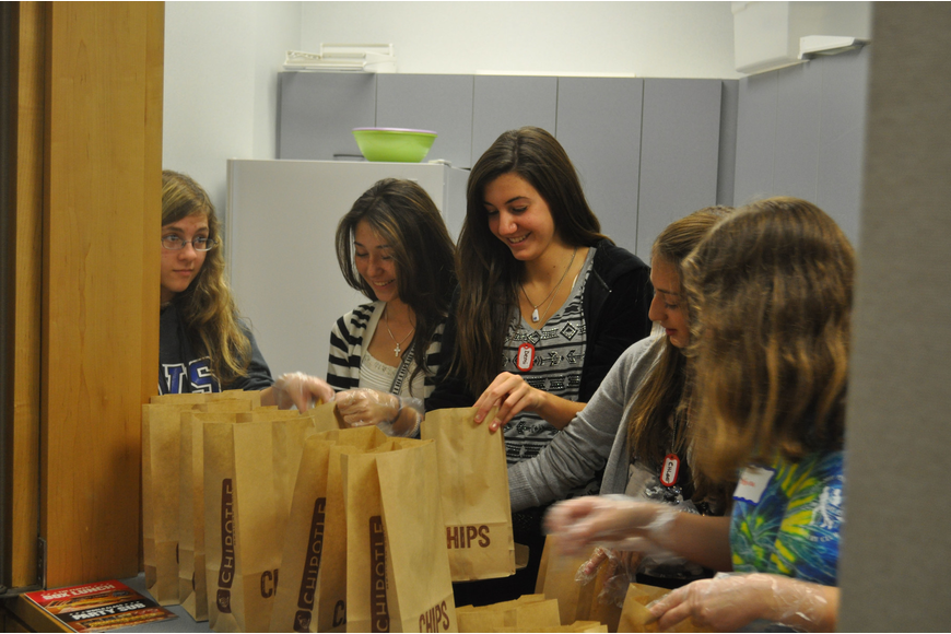 Samantha Chianese, Sofia Bever, Demi Giannopulos, Chloe Thacker and Sabrina Chianese help prepare snacks.
