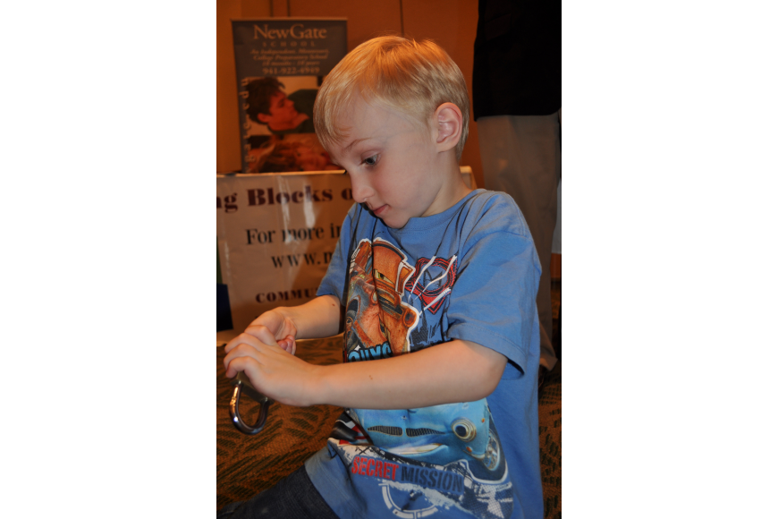 Reese Swanson, 5, tried out the lock lesson offered by New Gate School.