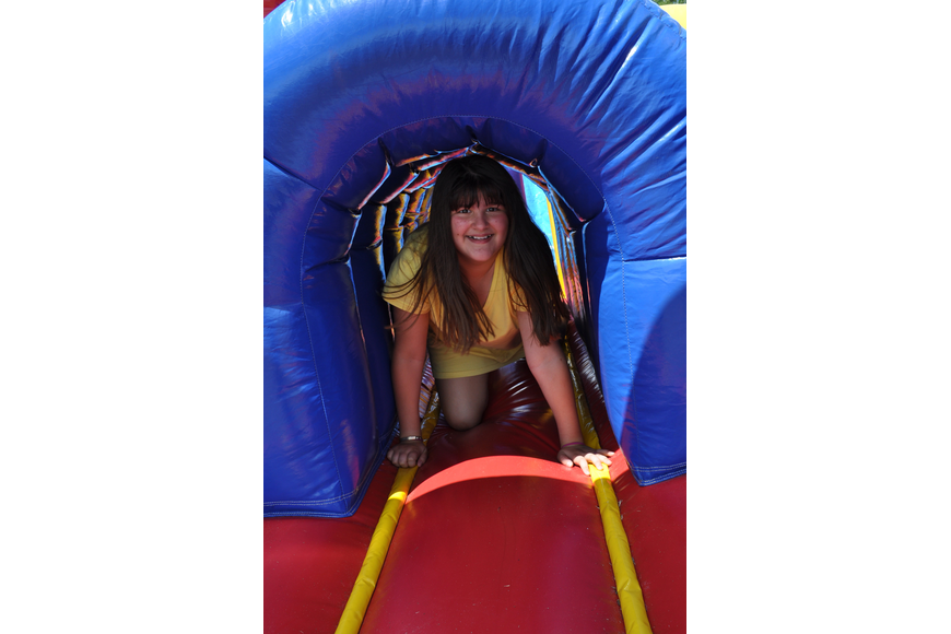 Alexa Affolter made sure to try out the inflatable obstacle course.