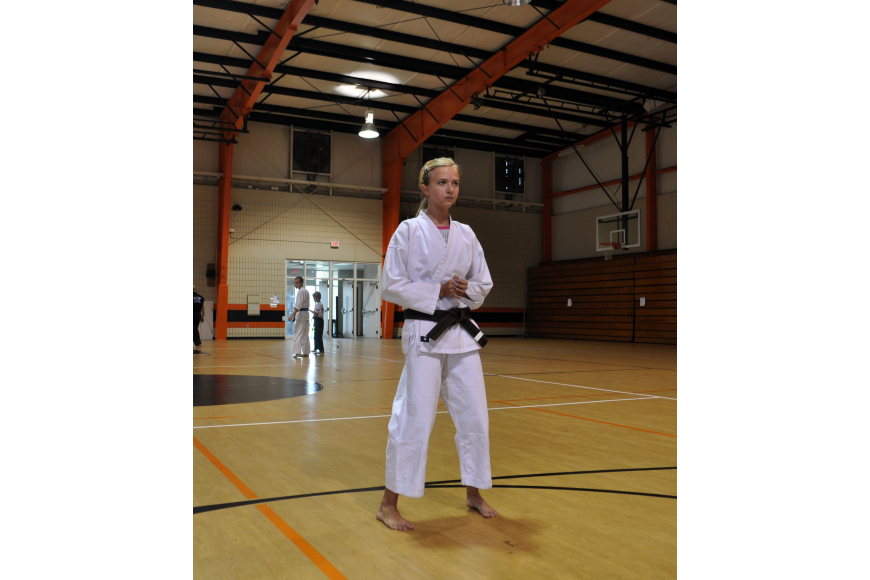 Sarah Hosford practices her kata, which is a series of choreographed martial arts techniques.