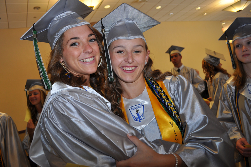 Nicole Himmler gives a hug to her friend and fellow Lakewood Ranch High graduate Taylor Halligan.