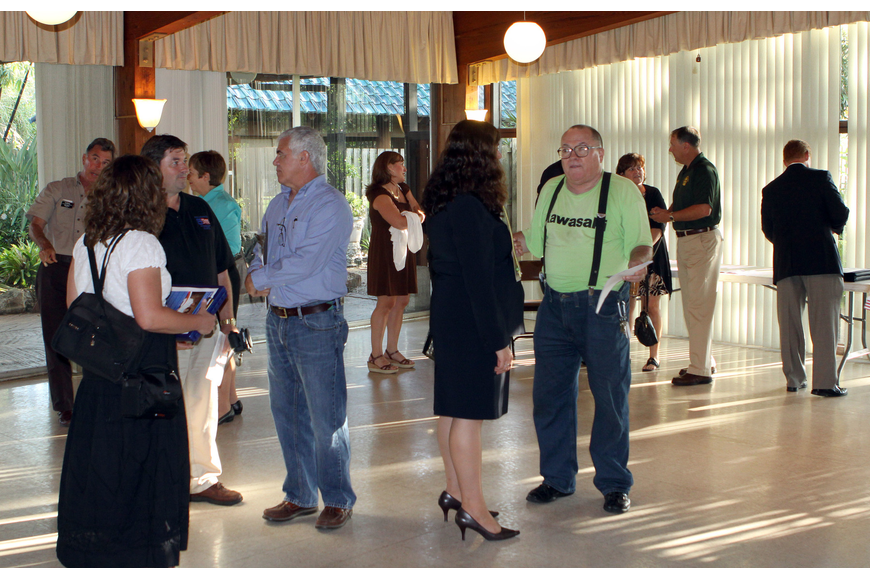 Locals talk to the candidates as well as other members of the community before the start of the CONA meeting, Monday, June 11, at the Sarasota Garden Club.