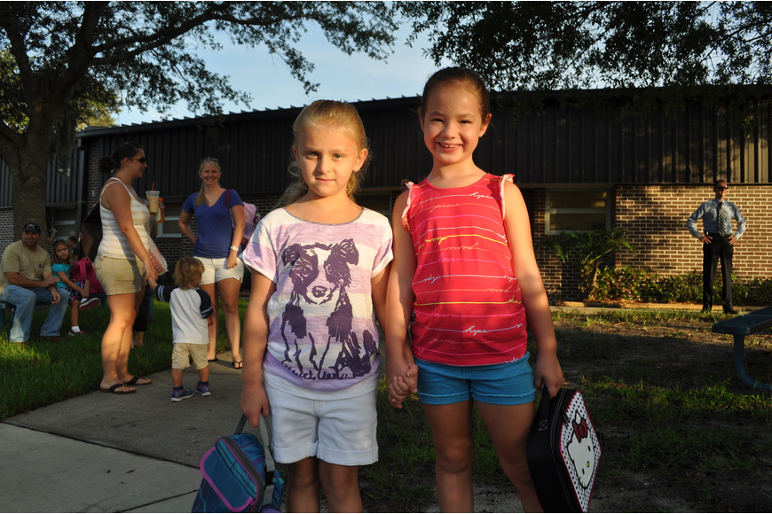 Kayla Rogers, first grade holds hands with her friend Miranda Phillips, first grade.