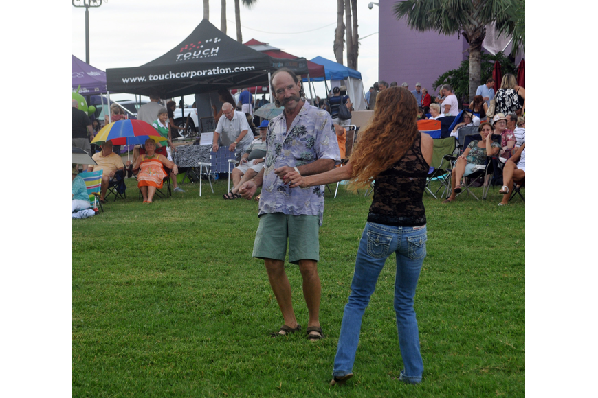 Ron Ellis and Leta Smith dance during the Bird Street Players' set.
