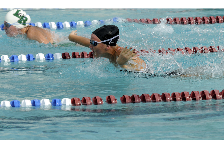 Braden River's Molly Lightner attempts to chase down Lakewood Ranch's Morgan Scott in the 100-yard butterfly.
