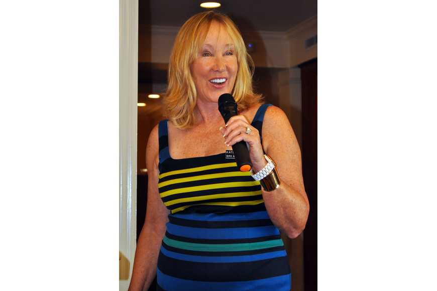 Katie Cornell, the chair of the style shows, talks to the crowd Thursday, Sept. 27 at Bird Key Yacht Club.