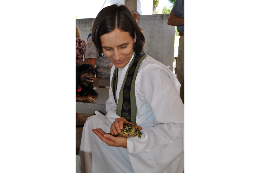 Associate Rector Andi Taylor blesses Easter, 23, at the Animal Blessing Sunday, Sept. 30 at St. Boniface Episcopal Church.