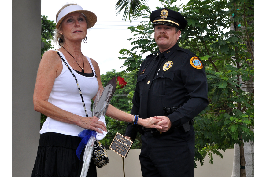 """I hope you come by and have good memories of a great man,"" said Leslie Hogle Wednesday, Oct. 3 during the tree dedication ceremony for her late husband, Al Hogle, at the Longboat Key Police Station."