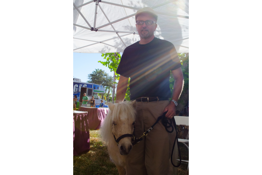"Dan Nagel and his miniature pony represented the Majestic Ministries of Christ. They have 16 ponies and use them for outreach programs.  ""We are a church that is open to all people and we wanted to make sure people knew that."""