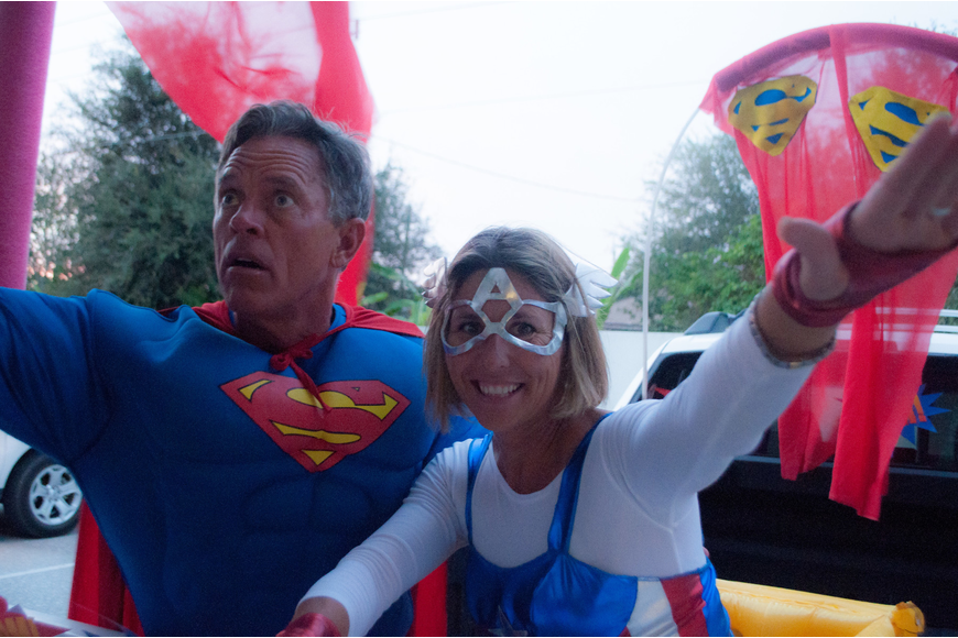 Ginger Rosenberger, the IB coordinator, and her husband Greg set up a Superman themed vehicle where kids trick 'o' trunked.