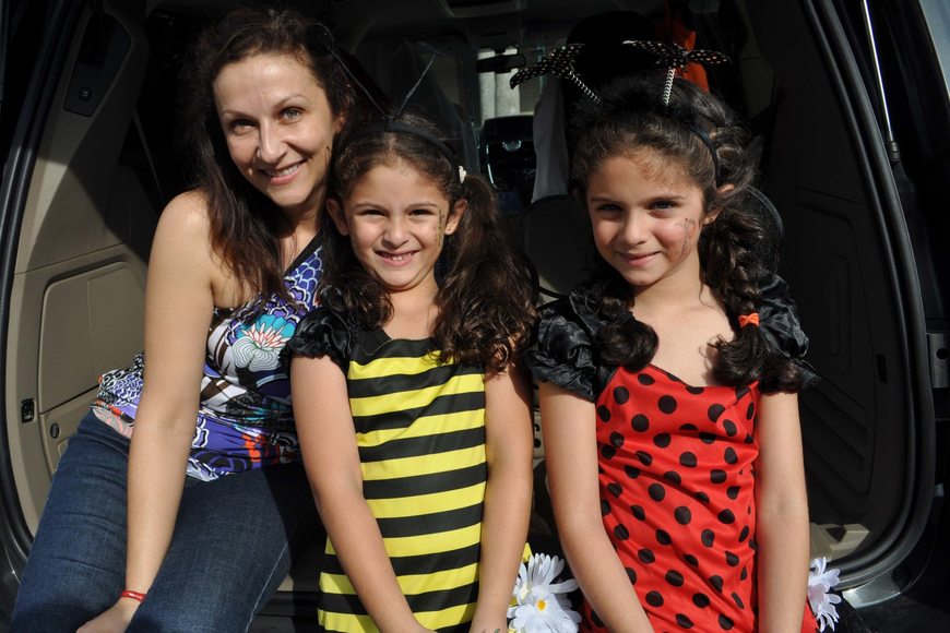 Dr. Dora Jarquin passed out candy her daughters, Kayla and Kiana Foroughi.