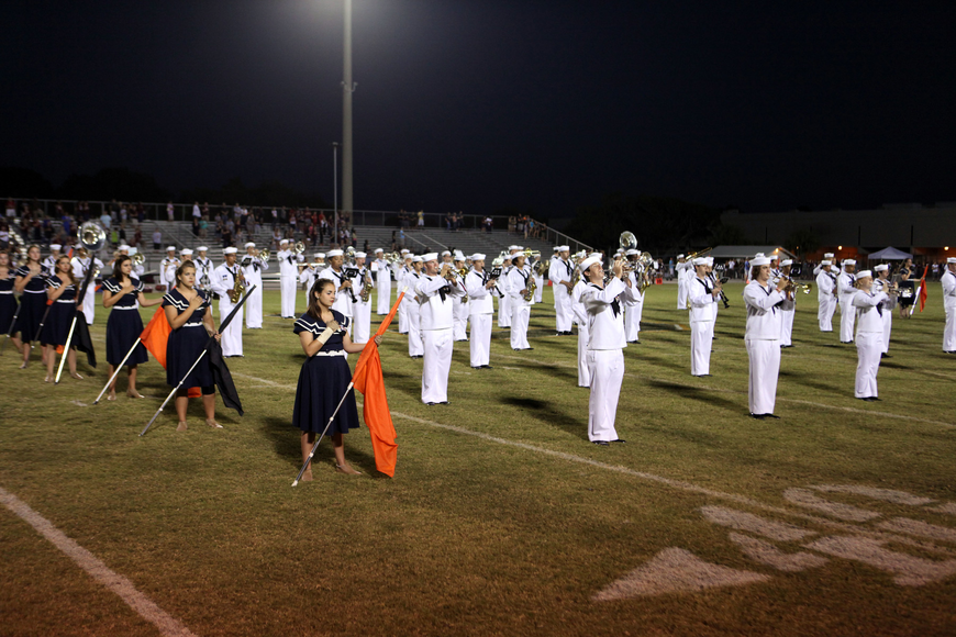 The Sarasota High School Band plays the National Anthem.