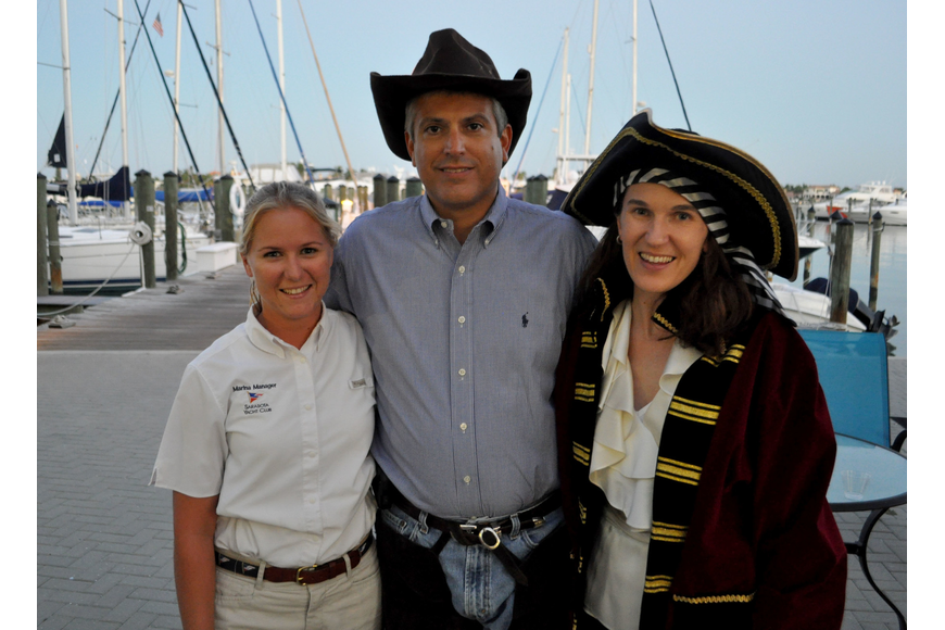 Amanda Holm, Commodore Lee Goodman and his wife, Courtney
