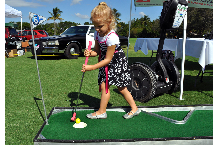 Mallory Sturm, 4, has fun putting.