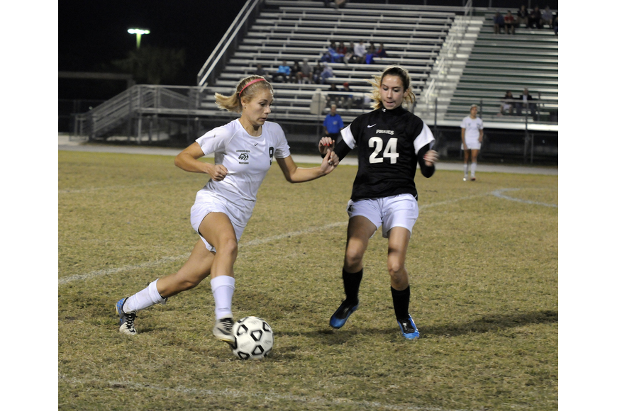 Lakewood Ranch defender Amanda Baar attempts to maneuver the ball past Braden River's Courtney Hart.