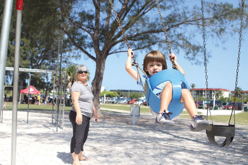 Gail Donovan pushed her grandson, Niccolo Aretini, 4, on a swing at a St. Boniface Preschool picnic May 5 at Siesta Key Beach Park.