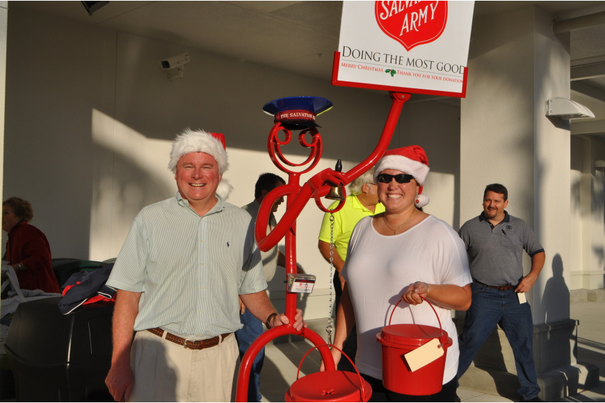 Jack Brill and his daughter, Vickie Brill, were the first Salvation Army bell ringers at the new store.