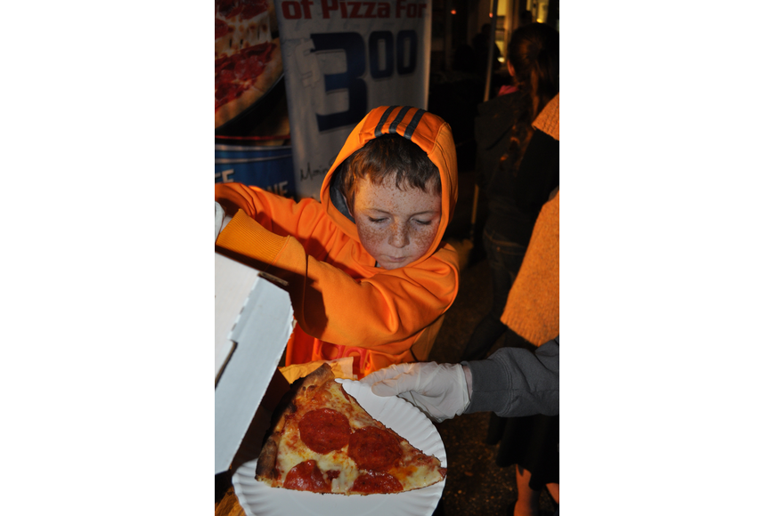 Max Fennessy, 10, helped his mom and sisters serve pizza from the family's restaurant, Main Street Trattoria.