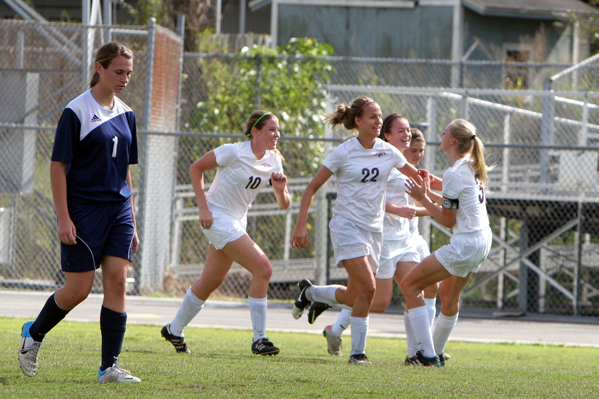 Riverview's Kendal Gollnick's, No. 22, teammates congratulate her on scoring the first goal of the game Saturday, Jan. 12, against North Port at Riverview High School.