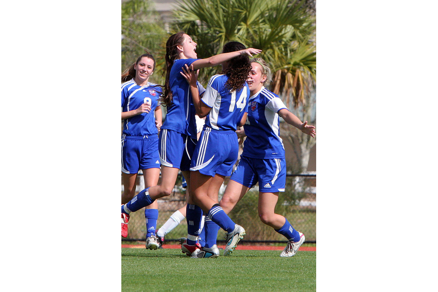 Northside Christian celebrate after scoring their first goal of the game.