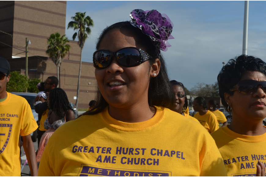 Eboni Curry sets off on the march from Booker High School.