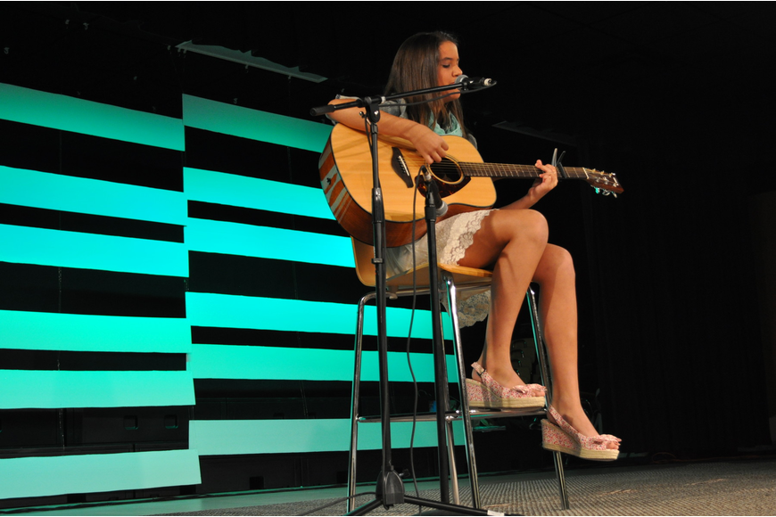 Emily Roman sang and played the guitar.
