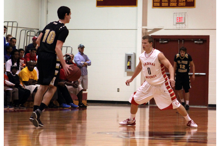 St. Petersburg Catholic's Mike Fridella, No. 10, tries to dribble past Cardinal Mooney's Jamie Glasser, No. 0.