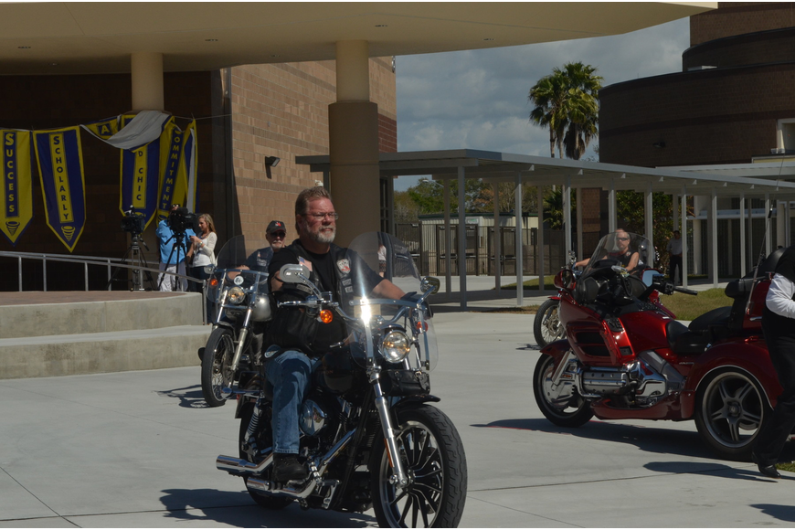 Motorcycle enthusiasts rode around the courtyard adding to the energy of the rally.