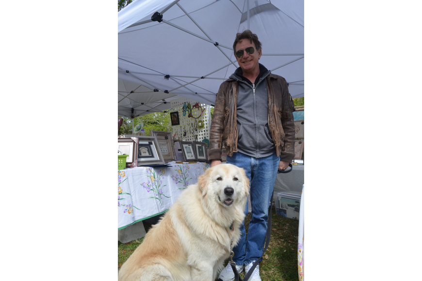 Jonathan Pettus strolled through the park with his maremma, or Italian sheep dog, Buca.