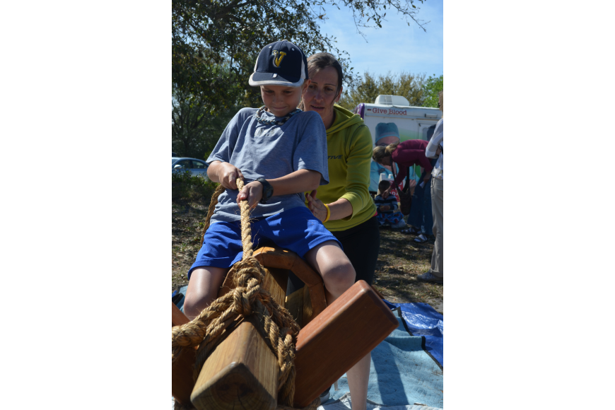 Garret Parisi, 10, takes a ride on a wooden battle horse with the assistance of Krisztina Ihaszy in Pinocchio's Land. Ihaszy makes the games herself.