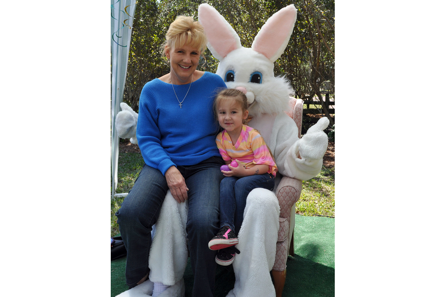 Lori Hunter and her granddaughter, Brielle Short, 4, sit on the Easter Bunny's lap for a photo at Jungle Gardens' 12th annual Jungle Trails and Bunny Tails.