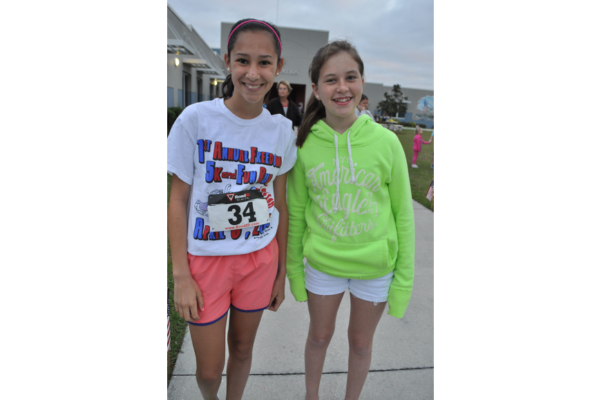 Jenna Mennes ran in the 5K, as her friend, Hallie Madden, watched.