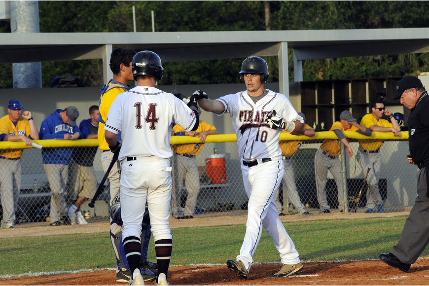 Braden River's Eric Schappacher congratulates Dylan Lee as he crosses home plate following his solo home run in the bottom of the first inning.