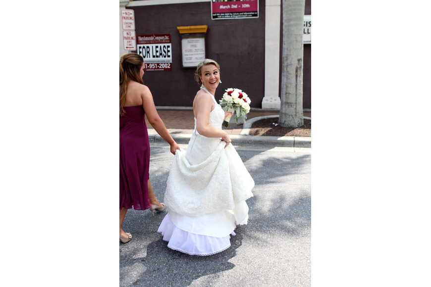 Emily Forbes crosses the street during a quick photo session before the wedding.