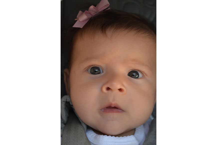 Three – month - old Jessica Toman came to her older sister, Alexandra's graduation.